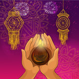 Human Hand with Oil Lamp for Diwali celebration. Royalty Free Stock Photos