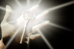 Human hand with an old key. Picture of a Human hand with an old key Stock Photo