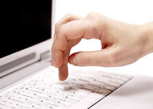 Human hand over laptop keypad during typing. Royalty Free Stock Images