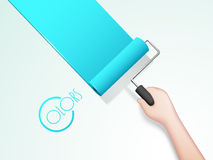 Human hand painting wall with roller brush. Stock Photo