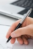 Human hand with pen Stock Photography