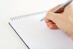 Human hand with pen. Royalty Free Stock Photo