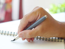 human hand with pen Stock Images