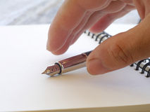 human hand with pen Royalty Free Stock Photo