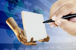 Human hand with pen drawing Royalty Free Stock Image