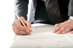 Human hand with pen makes signature Stock Photography