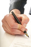 Human hand with pen makes signature Royalty Free Stock Photos