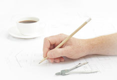 Human hand with pencil. Stock Photos