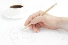 Human hand with pencil. Stock Photos