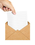 Human hand pick the letter up from the envelope Stock Images