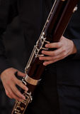 Human hand playing the bassoon Stock Images