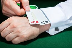 Human hand with playing cards in sleeve Stock Image