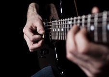 Human hand playing an electric guitar Stock Photography