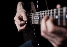Human hand playing an electric guitar Stock Photography