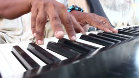Human hand playing Electric piano stock video footage