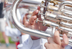 Human hand playing the flugelhorn stock image