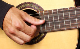 Human hand playing guitar Royalty Free Stock Images