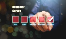 Human hand pointing on excellent box with customer survey concept. stock photo