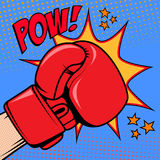 Human hand in pop art style with boxing glove. Pow. Design eleme Royalty Free Stock Photo