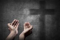 Human hand praying to god. Religious concept image stock photography