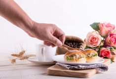 Human hand prepare breakfast tuna sandwich Stock Photo