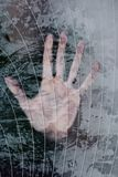 Human hand is pressed to glass. Human hand is pressed to the glass covered with hoarfrost Royalty Free Stock Images