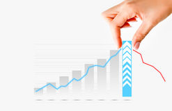 Human hand pulling graph bar suggesting increase of sales or business Royalty Free Stock Images