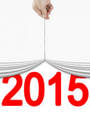 Human hand pulling up white curtain with bright red 2015 Royalty Free Stock Photos