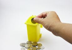 Human hand put coin in coin box Royalty Free Stock Photo