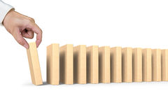 Human hand putting domino in line Stock Photography