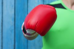 Human hand in a red boxing glove. Selective focus Royalty Free Stock Photography