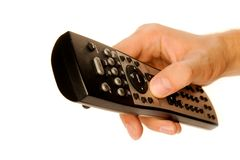 Human hand on remote Stock Image