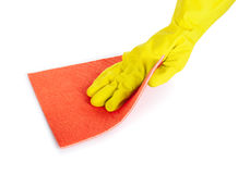 Human hand with rubber glove wiping with a cloth Royalty Free Stock Image