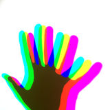 A human hand shades on a wall with RGB colours Stock Photos