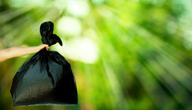 Human hand showing garbage bag Stock Photo