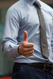 Human Hand Showing Thumbs Up On The Foreground Stock Image