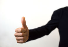 Human hand showing thumbs up on the white foreground Royalty Free Stock Photo
