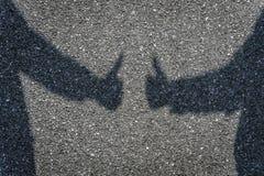 Human Hand Sign. On Asphalt Royalty Free Stock Photography