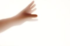 Human hand silhouete on the frosted glass. With space for text or image Royalty Free Stock Photo