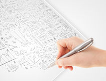 Human hand sketching ideas on a white paper Royalty Free Stock Photography