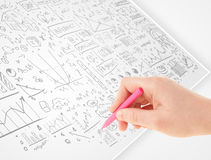 Human hand sketching ideas on a white paper Stock Photo