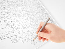 Human hand sketching ideas on a white paper Royalty Free Stock Images