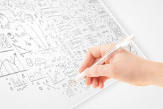 Human hand sketching ideas on a white paper Royalty Free Stock Image
