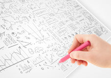 Human hand sketching ideas on a white paper Royalty Free Stock Photos