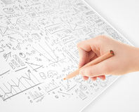 Human hand sketching ideas on a white paper Stock Image