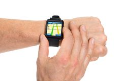 Human hand with smartwatch showing gps map Stock Image