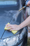 Human hand with sponge soap washing car Royalty Free Stock Photography