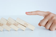Human hand starting a domino effect concept Royalty Free Stock Image