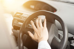 Human hand on steering and honking Stock Photos