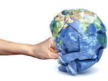 Human hand strikes the planet earth Royalty Free Stock Images